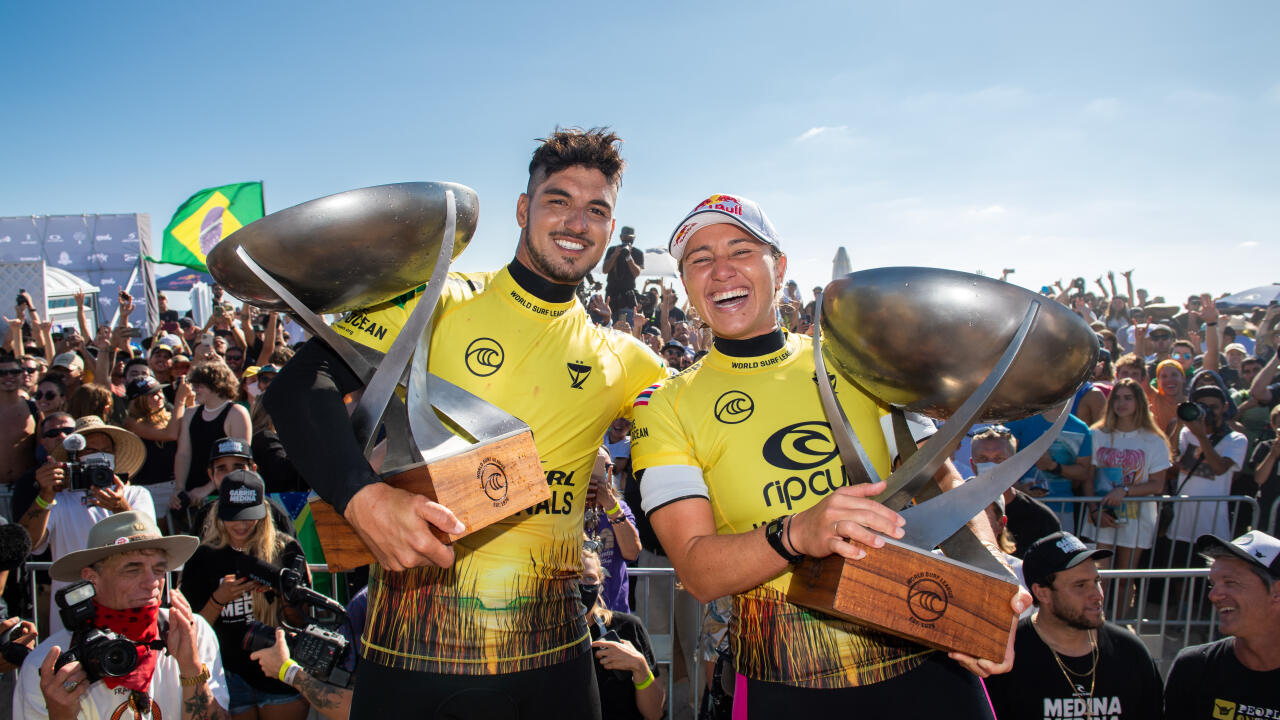 SAN CLEMENTE, CALIFORNIA, USA - SEPTEMBER 14: Four-time WSL Champion Carissa Moore of Hawaii and two-time WSL Champion Gabriel Medina of Brazil after surfing in the Title Match of the Rip Curl WSL Finals on September 14, 2021 at Lower Trestles, San Clemen